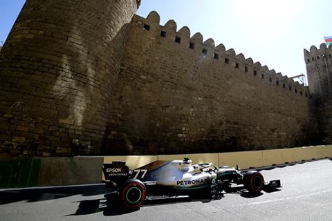 Mercedes driver Valtteri Bottas of Finland steers his car during the third free practice at the Baku Formula One city circuit in Baku, Azerbaijan, Saturday, April 27, 2019. The Azerbaijan F1 Grand Prix race will be held on Sunday. (AP Photo/Sergei Grits)