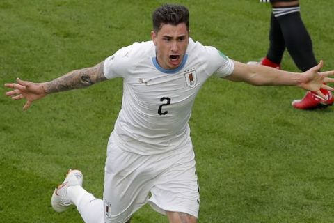 Uruguay's Jose Gimenez scores the opening goal during the group A match between Egypt and Uruguay at the 2018 soccer World Cup in the Yekaterinburg Arena in Yekaterinburg, Russia, Friday, June 15, 2018. (AP Photo/Vadim Ghirda)