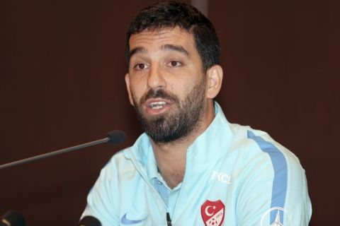 Barcelona midfielder Arda Turan announces during a short press conference in Portoroz, Slovenia, Tuesday, June 6, 2017, that he is ending his Turkey International career after he was dropped from the country's national team after reportedly attacking a sports journalist aboard a team plane. Turkey coach Fatih Terim ousted Turan from the national squad and also kicked him out of a training camp in Slovenia ahead of a World Cup qualifier against Kosovo on Sunday, Turkish media reports said.(AP Photo)