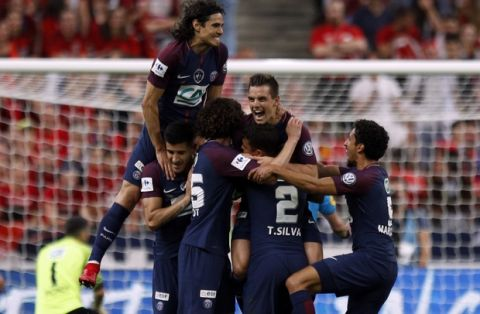 PSG's Giovani Lo Celso, center, is congratulated by teammates after scoring his side opening goal during the French Cup soccer final Paris Saint Germain against Les Herbiers at the Stade de France stadium in Saint-Denis, outside Paris, Tuesday, May 8, 2018. (AP Photo/Francois Mori)