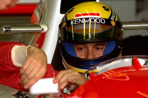 Formula One champion Ayrton Senna of Brazil adjusts the rear view mirror of his McLaren Ford prior to practices for the French Formula One Grand Prix on Friday July 2, 1993. (AP PHOTO/REMY DE LA MAUVINIERE)