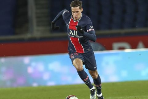 PSG's Julian Draxler controls the ball during the French League One soccer match between Paris Saint-Germain and Nimes at the Parc des Princes stadium in Paris, France, Wednesday, Feb. 3, 2021. (AP Photo/Michel Euler)