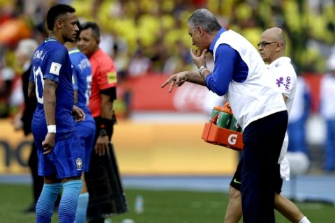 Brazil's coach Tite, right, gives instructions to Neymar, right, during a 2018 Russia World Cup qualifying soccer match against Colombia, at the Roberto Melendez stadium in Barranquilla, Colombia, Tuesday, Sept. 5, 2017. (AP Photo/Fernando Vergara)