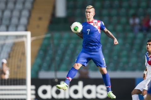 Croatias's Marko Livaja stops the ball during the Under-20 World Cup round of 16 soccer match between Croatia and Chile in Bursa, Turkey, Wednesday, July 3, 2013. (AP Photo/Gero Breloer)