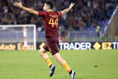 Roma¢s Kostas Manolas celebrates after scoring during a Serie A soccer match between Roma and Inter Milan, at Rome's Olympic Stadium, Sunday, Oct. 2, 2016. (AP Photo/Andrew Medichini)