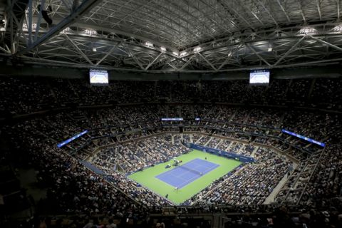 Naomi Osaka, of Japan, plays Madison Keys under a closed roof during the semifinals of the U.S. Open tennis tournament, Thursday, Sept. 6, 2018, in New York. (AP Photo/Andres Kudacki)