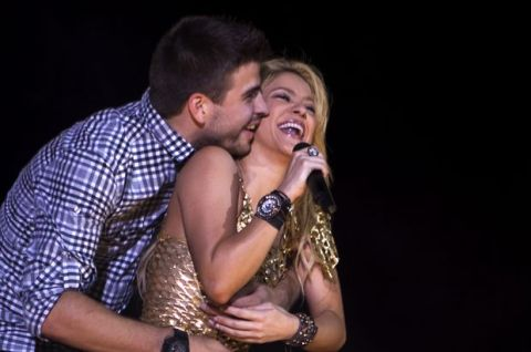 """FILE - In this May 29, 2011 file photo, Colombia's pop star singer Shakira performs with FC Barcelona Gerard Pique during her """"The Sun Comes Out World Tour"""" concert in Barcelona, Spain. Shakira says she has given birth to a boy her second child with partner, Spanish football star Gerard Pique. In a statement on her official Twitter account Friday, Jan. 30, 2015, Shakira, 37, said Sasha Pique Mebarak was born Thursday at 9.54 p.m. in Barcelona, Spain. (AP Photo/Emilio Morenatti, File)"""