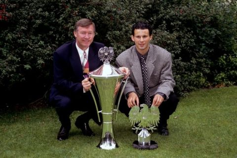 (L-R) Manchester United manager Alex Ferguson shows off his Manager of the Year trophy alongside Ryan Giggs, proud recipient of the Young Eagle of the Year