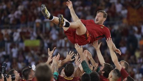 Roma's Francesco Totti is tossed in the air by his teammates after an Italian Serie A soccer match between Roma and Genoa at the Olympic stadium in Rome, Sunday, May 28, 2017. Francesco Totti played his final match with Roma against Genoa after a 25-season career with his hometown club. (AP Photo/Alessandra Tarantino) an Italian Serie A soccer match between Roma and Genoa at the Olympic stadium in Rome, Sunday, May 28, 2017. Francesco Totti is playing his final match with Roma against Genoa after a 25-season career with his hometown club. (AP Photo/Alessandra Tarantino)