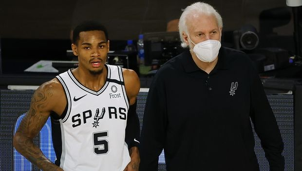 San Antonio Spurs head coach Gregg Popovich, right, talks with Dejounte Murray (5) during the first quarter of an NBA basketball game against the Utah Jazz, Thursday, Aug. 13, 2020, in Lake Buena Vista, Fla. (Kevin C. Cox/Pool Photo via AP)