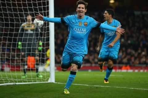 LONDON, ENGLAND - FEBRUARY 23:  Lionel Messi of Barcelona celebrates after scoring his second goal during the UEFA Champions League round of 16 first leg match between Arsenal and Barcelona on February 23, 2016 in London, United Kingdom.  (Photo by Paul Gilham/Getty Images)