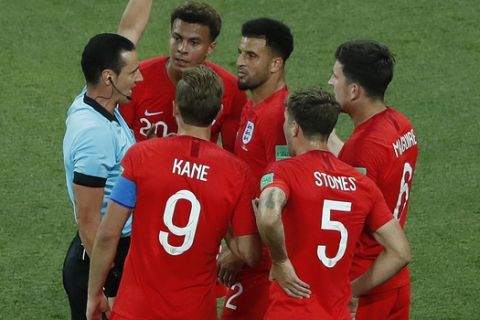 England's Kyle Walker, center, gets a yellow card during the group G match between Tunisia and England at the 2018 soccer World Cup in the Volgograd Arena in Volgograd, Russia, Monday, June 18, 2018. (AP Photo/Rebecca Blackwell)