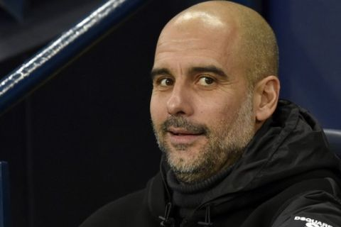 Manchester City's head coach Pep Guardiola during the English Premier League soccer match between Manchester City and Chelsea at Etihad stadium in Manchester, England, Saturday, Nov. 23, 2019. (AP Photo/Rui Vieira)