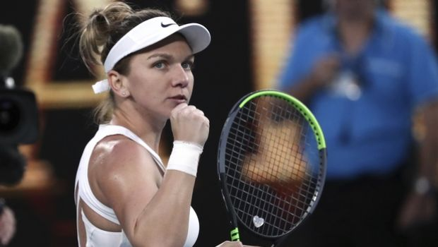 Romania's Simona Halep reacts after defeating Britain's Harriet Dart during their second round singles match at the Australian Open tennis championship in Melbourne, Australia, Thursday, Jan. 23, 2020. (AP Photo/Dita Alangkara)