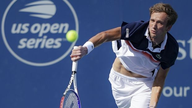 Daniil Medvedev, of Russia, serves to David Goffin, of Belgium, in the men's final match during the Western & Southern Open tennis tournament Sunday, Aug. 18, 2019, in Mason, Ohio. (AP Photo/John Minchillo)