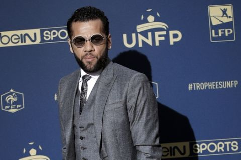 PSG's Dani Alves poses as he arrives at the UNFP (Union of French Professional Footballers) ceremony, in Paris, Sunday, May 13, 2018. (AP Photo/Christophe Ena)