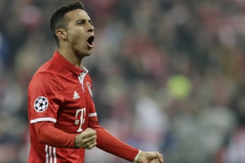 Bayern's Thiago Alcantara celebrates after his teammate Robert Lewandowski scored his side's second goal during the Champions League round of 16 first leg soccer match between FC Bayern Munich and Arsenal, in Munich, Germany, Wednesday, Feb. 15, 2017. (AP Photo/Matthias Schrader)