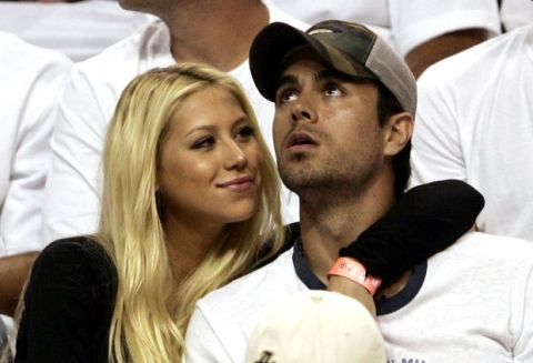 Anna Kournikova and Enrique Iglesias are seen during Game 1 of the second round of the NBA basketball playoffs between the New Jersey Nets and the Miami Heat at the American Airlines Arena in Miami, Monday, May 8, 2006. (AP Photo/J.Pat Carter)