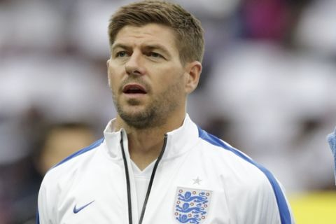 England captain Steven Gerrard stands in a team line up during the playing of the national anthems before the international friendly soccer match between England and Peru at Wembley Stadium in London, Friday, May 30, 2014.  (AP Photo/Matt Dunham)