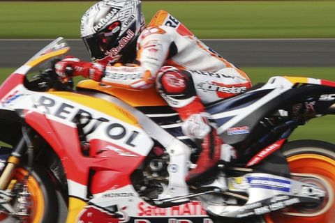 Repsol Honda's Marc Marquez of Spain, during a practice session ahead of the MOTO British Grand Prix at Silverstone racetrack Friday Aug. 25, 2017. (David Davies/PA via AP)