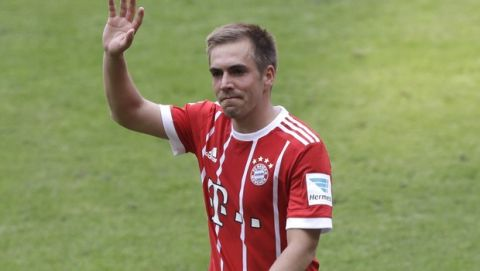 Bayern's Philipp Lahm waves to spectators as he leaves the field during the German first division Bundesliga soccer match between FC Bayern Munich and SC Freiburg at the Allianz Arena stadium in Munich, Germany, Saturday, May 20, 2017. (AP Photo/Matthias Schrader)