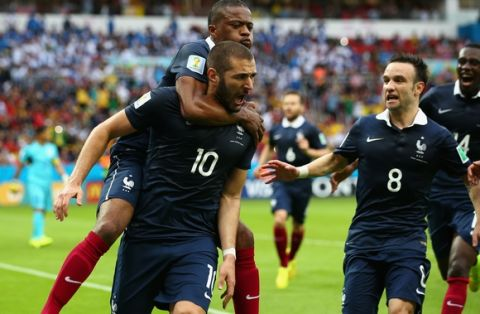 PORTO ALEGRE, BRAZIL - JUNE 15:  Karim Benzema of France celebrates scoring the first goal with Patrice Evra, Mathieu Valbuena during the 2014 FIFA World Cup Brazil Group E match between France and Honduras at Estadio Beira-Rio on June 15, 2014 in Porto Alegre, Brazil.  (Photo by Ian Walton/Getty Images)