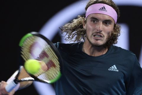 Greece's Stefanos Tsitsipas makes a backhand return to Spain's Rafael Nadal during their semifinal at the Australian Open tennis championships in Melbourne, Australia, Thursday, Jan. 24, 2019. (AP Photo/Andy Brownbill)