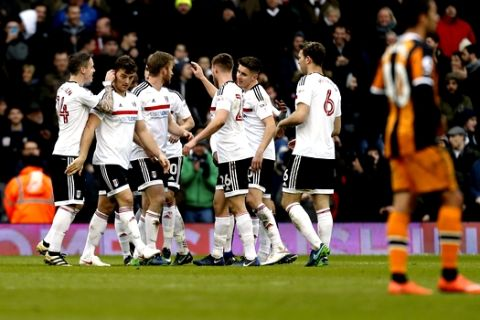 Fulham's Chris Martin, second left, celebrates scoring his side's second goal of the game with his teammates during the English FA Cup, Fourth Round match, Fulham vs Hull City at Craven Cottage, London, Sunday Jan. 29, 2017. (Paul Harding/PA via AP)