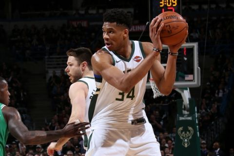 MILWAUKEE, WI - APRIL 26:  Giannis Antetokounmpo #34 of the Milwaukee Bucks handles the ball against the Boston Celtics in Game Six of the Round One of the 2018 NBA Playoffs on April 26, 2018 at the BMO Harris Bradley Center in Milwaukee, Wisconsin. NOTE TO USER: User expressly acknowledges and agrees that, by downloading and or using this Photograph, user is consenting to the terms and conditions of the Getty Images License Agreement. Mandatory Copyright Notice: Copyright 2018 NBAE (Photo by Gary Dineen/NBAE via Getty Images)