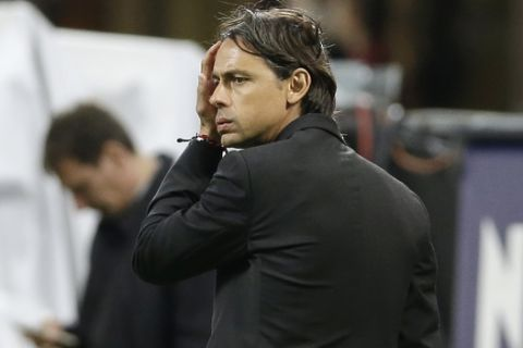 AC Milan coach Filippo Inzaghi touches his forehead during the Serie A soccer match between AC Milan and Genoa at the San Siro stadium in Milan, Italy, Wednesday, April 29, 2015. (AP Photo/Antonio Calanni)