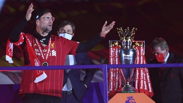 Liverpool's manager Jurgen Klopp celebrates after getting his winners medal following the English Premier League soccer match between Liverpool and Chelsea at Anfield Stadium in Liverpool, England, Wednesday, July 22, 2020. Liverpool are champions of the EPL for the season 2019-2020. The trophy is presented at the teams last home game of the season. Liverpool won the match against Chelsea 5-3. (Laurence Griffiths, Pool via AP)