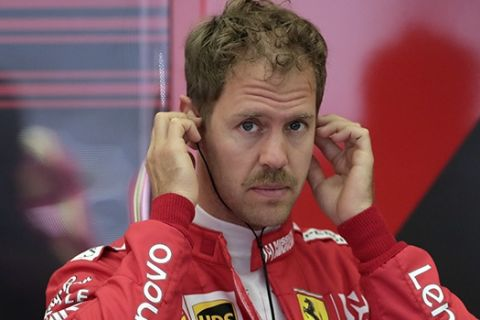 Ferrari driver Sebastian Vettel of Germany prepares for the first free practice at the Formula One Bahrain International Circuit in Sakhir, Bahrain, Friday, March 29, 2019. The Bahrain Formula One Grand Prix will take place on Sunday. (AP Photo/Hassan Ammar)