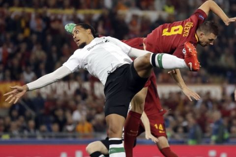 Liverpool's Virgil Van Dijk jumps for the ball with Roma's Edin Dzeko, right, during the Champions League semifinal second leg soccer match between Roma and Liverpool at the Olympic Stadium in Rome, Wednesday, May 2, 2018. (AP Photo/Alessandra Tarantino)