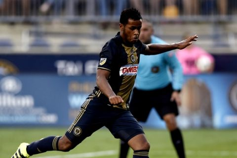 Philadelphia Union's Roland Alberg takes a penalty kicks and scores on Real Salt Lake goalie Nick Rimando during the first half of an MLS soccer match on Sunday, July 31, 2016, in Chester, Pa. (AP Photo/Michael Perez)