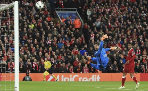 AS Roma's Ramses Alisson fails to stop Liverpool's Mohamed Salah's shot going in for Liverpool's first goal during their Champions League, Semifinal first leg soccer match at Anfield, Liverpool, England, Tuesday April 24, 2018. (Peter Byrne/PA via AP)