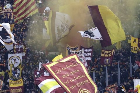Fans cheer before the Serie A soccer match between Roma and Juventus at the Rome Olympic Stadium, Italy, Sunday, Jan. 12, 2020. (AP Photo/Andrew Medichini)
