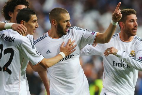 MADRID, SPAIN - APRIL 23:  Karim Benzema of Real Madrid celebrates scoring the opening goal with team mates during the UEFA Champions League semi-final first leg match between Real Madrid and FC Bayern Muenchen at the Estadio Santiago Bernabeu on April 23, 2014 in Madrid, Spain.  (Photo by Martin Rose/Bongarts/Getty Images)