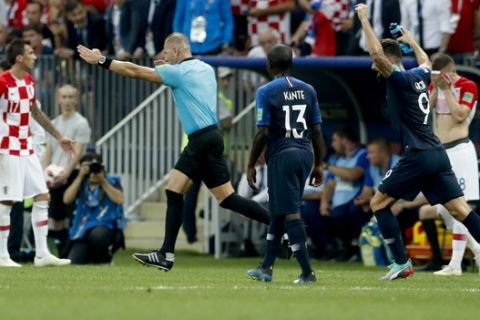 Referee Nestor Pitana from Argentina points to the penalty box during the final match between France and Croatia at the 2018 soccer World Cup in the Luzhniki Stadium in Moscow, Russia, Sunday, July 15, 2018. (AP Photo/Petr David Josek)