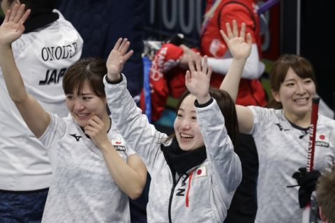 Japan's skip Satsuki Fujisawa, center, and teammates wave to the crowd after defeating Britain in their match for bronze at the 2018 Winter Olympics in Gangneung, South Korea, Saturday, Feb. 24, 2018. Japan won the bronze. (AP Photo/Aaron Favila)
