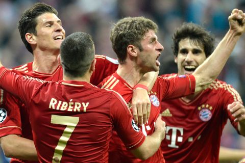 Bayern Munich's midfielder Thomas Mueller (2dR) celebrates scoring a goal with teammates striker Mario Gomez (L) and French midfielder Franck Ribery (C) during the UEFA champions league semi final first leg football match FC Bayern Muenchen vs FC Barcelona on April 23, 2013 in Munich, southern Germany.  AFP PHOTO CHRISTOF STACHE        (Photo credit should read CHRISTOF STACHE/AFP/Getty Images)