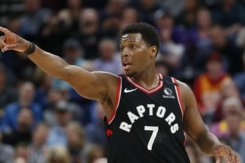 Toronto Raptors guard Kyle Lowry (7) directs his team in the first half during an NBA basketball game against the Utah Jazz, Monday, March 9, 2020, in Salt Lake City. (AP Photo/Rick Bowmer)