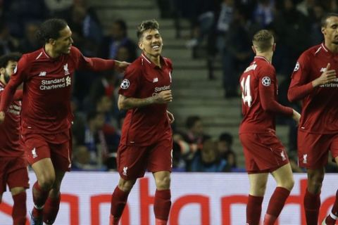 Liverpool's Roberto Firmino, center, celebrates after scoring his side's third goal during the Champions League quarterfinal, 2nd leg, soccer match between FC Porto and Liverpool at the Dragao stadium in Porto, Portugal, Wednesday, April 17, 2019. (AP Photo/Armando Franca)