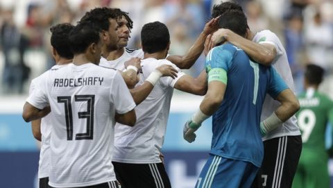 Egypt goalkeeper Essam El Hadary, right, is congratulated by his teammates after defending a penalty kick during the group A match between Saudi Arabia and Egypt at the 2018 soccer World Cup at the Volgograd Arena in Volgograd, Russia, Monday, June 25, 2018. (AP Photo/Andrew Medichini)