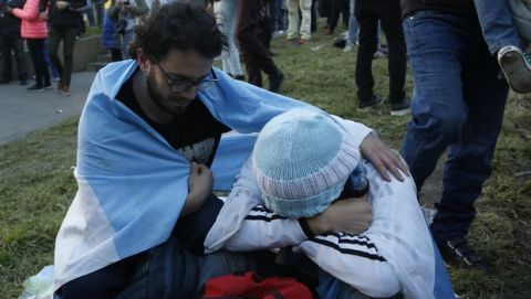 An Argentina fan comforts a friend at the end of a televised broadcast of the Croatia vs Argentina World Cup soccer match, in Buenos Aires, Argentina, Thursday, June 21, 2018. Argentina lost 3-0 to Croatia. (AP Photo Jorge Saenz)