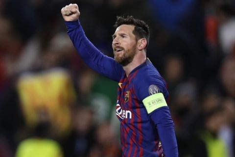 Barcelona forward Lionel Messi celebrates after scoring his side's opening goal from a penalty spot during the Champions League round of 16, 2nd leg, soccer match between FC Barcelona and Olympique Lyon at the Camp Nou stadium in Barcelona, Spain, Wednesday, March 13, 2019. (AP Photo/Manu Fernandez)