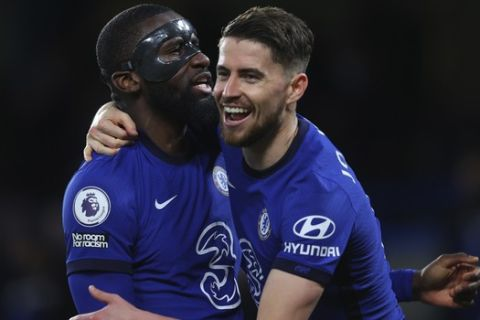 Chelsea's Jorginho, right, celebrates with Chelsea's Antonio Rudiger after scoring his side's second goal from penalty during the English Premier League soccer match between Chelsea and Leicester City at Stamford Bridge Stadium in London, Tuesday, May 18, 2021. (Catherine Ivill/Poolvia AP)