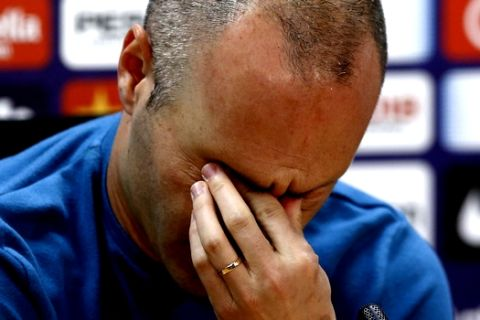 """F.C. Barcelona player Andres Iniesta reacts during a news conference announcing he is leaving the club, in Barcelona, Spain, Friday, April. 27, 2018. Andres Iniesta says that he will leave Barcelona this summer after 16 trophy-packed seasons with the Spanish club. Iniesta, who turns 34 on May 11, says Friday """"this season is the last."""" (AP Photo/Manu Fernandez)"""