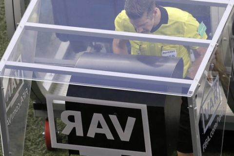 FILE - In this Friday, June 22, 2018 file photo, eeferee Matt Conger from New Zealand watches the Video Assistant Referee system, known as VAR during the group D match between Nigeria and Iceland at the 2018 soccer World Cup in the Volgograd Arena in Volgograd, Russia. The video assistant referee system has been much talked about since being used at the World Cup earlier this year, and on Sunday Sept. 30, 2018, VAR stopped working during the 1-1 draw between Rennes and Toulouse. (AP Photo/Themba Hadebe, File)