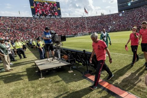 Manchester United manager Jose Mourinho walks off the pitch after the first half of an International Champions Cup tournament soccer match against Liverpool at Michigan Stadium, Saturday, July 28, 2018, in Ann Arbor, Mich. (AP Photo/Tony Ding)