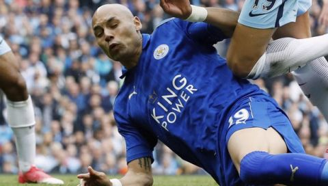 Manchester City's Leroy Sane is brought down inside the box by Leicester's Yohan Benalouane resulting in a penalty, during the English Premier League soccer match between Manchester City and Leicester, at the Etihad Stadium, in Manchester, England, Saturday May 13, 2017. (Martin Rickett/PA via AP)